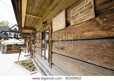 Facade Made Of Wooden Logs