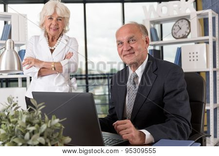 Elderly Couple In Bureau