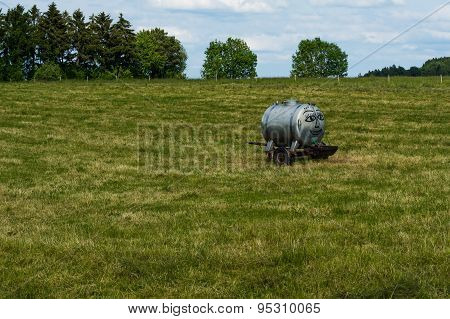 Smiling Water Tank On A Green Field
