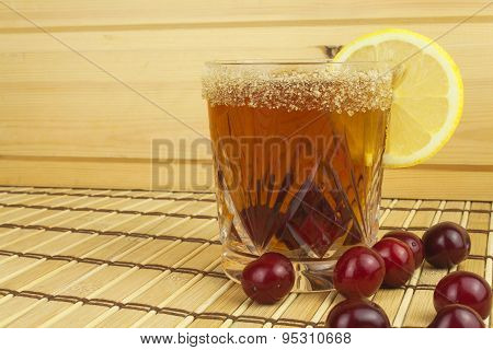 Glasses with cherries with rum. Preparing for summer refreshment cocktail. Cane rum and sugar.