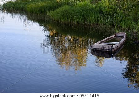 Old Wooden Boat By The River