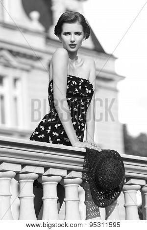 Fashion Woman On Ancient Balcony In Bw