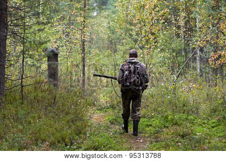 Hunter Shooting On The Walk In Forest