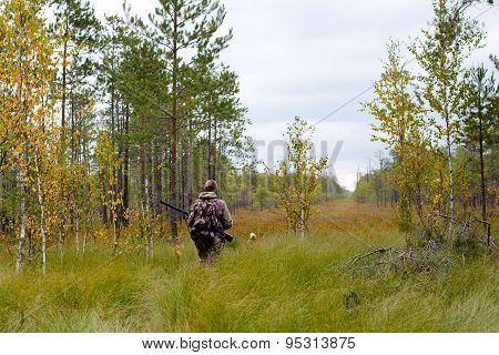 Hunter Walking On The Glade