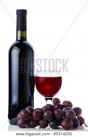 Red Wine In Glass, Bottle And Grapes