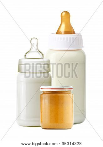Baby Milk Bottles And Jar Of Baby Puree Isolated On White