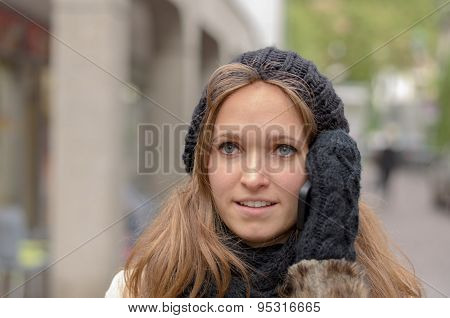 Young Woman Chatting On Her Mobile In Winter