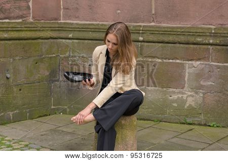 Stylish Young Woman With Aching Feet