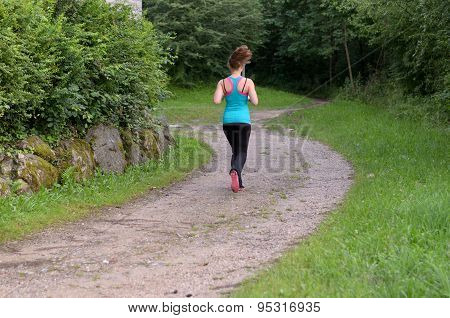 Young Healthy Fit Woman Jogging Outdoors