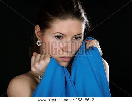 Portrait Of The Girl  Wrapped Up Dark Blue Fabric On A Black Background