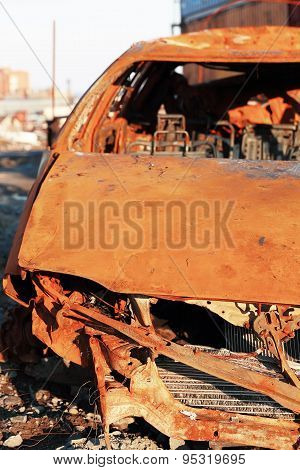 Rusty wrecked car