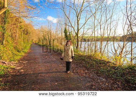 Woman Walking Outdoor. Sunny Day Orange Fall Leaves.