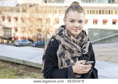 Modern Lifestyle Concepts: Trendy Teenager Girl Using Cellphone Outdoors