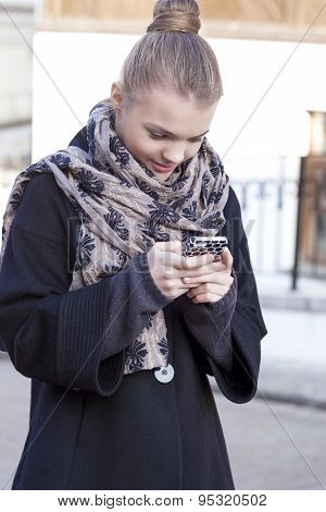 Youth Trends Concept: Teenage Caucasian Girl Dealing With Cellphone Outdoor.
