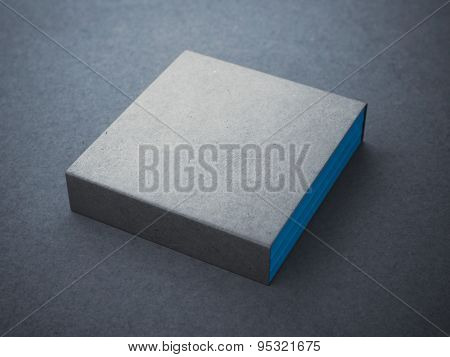 Three blue books with blank box cover
