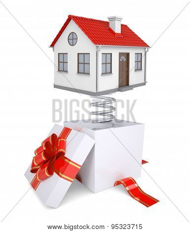 Gift box with red band and house