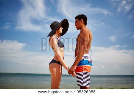 Amorous couple spending vacation by the sea