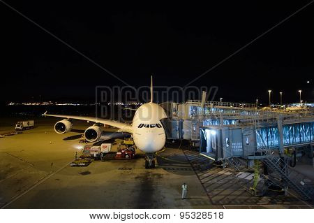 HONG KONG - JUNE 18, 2015: Emirates A380-800 docked in Airport. Emirates is one of two flag carriers of the United Arab Emirates along with Etihad Airways and is based in Dubai.