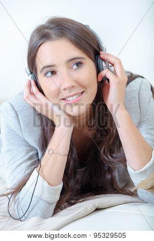 Young brunette is a music fan
