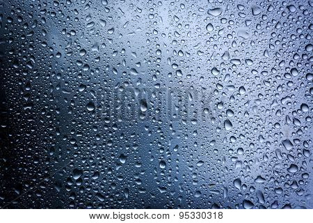 water drops on glass - abstract background