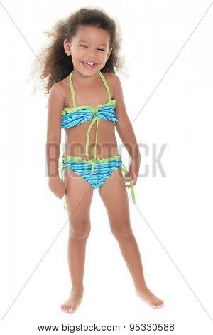 Cute small african-american or hispanic girl wearing a bikini isolated on white