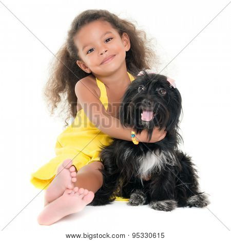 Cute small girl hugging her pet dog isolated on white
