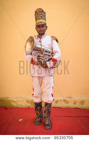GODWAR REGION, INDIA - 15 FEBRUARY 2015: Indian musician dressed in wedding ceremony outfit holds trumpet. Marriages in India are filled with ritual and celebration that go on for several days.