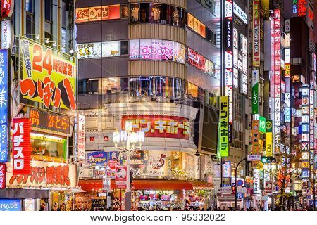 TOKYO, JAPAN - DECEMBER 29, 2012: Billboards in Shinjuku's Kabuki-cho district. The area is a nightlife district known as Sleepless Town.