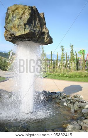 SOCHI, RUSSIA - JUL 28, 2014: Thematic Fountain Stone in Sochi Park. Streams of water supports huge boulders in weightlessness