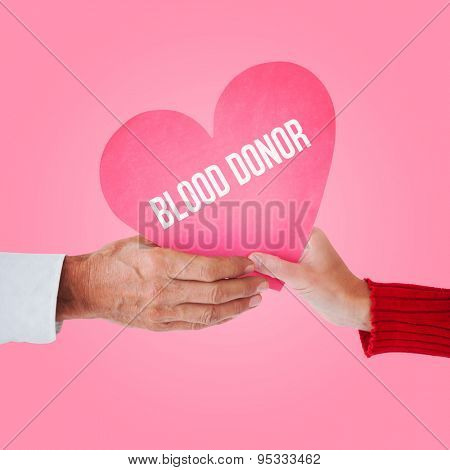 Couple holding heart against pink