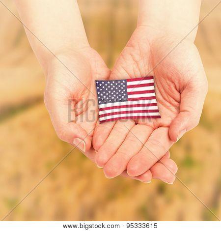 Hands presenting against rural fields