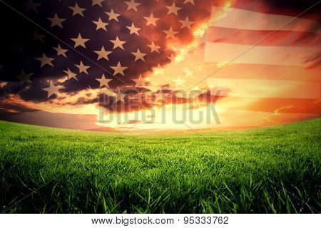United states of america flag against green field under orange sky