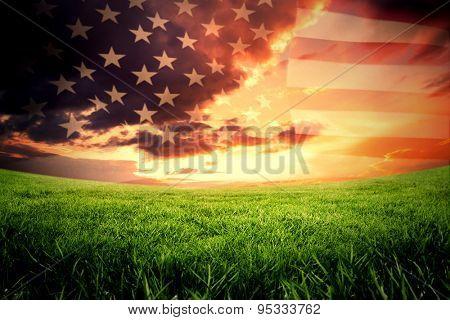 United states of america flag against green field under orange sky