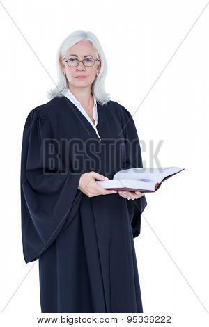 Happy lawyer looking at camera and holding law code on white background