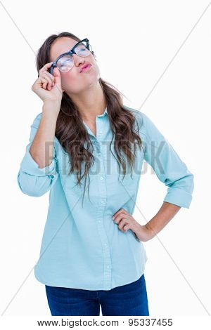 Pretty geeky hipster sending an air kiss on white background
