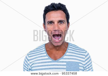 Shocked man looking at camera on white background