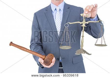 businessman holding scales of justice on white background