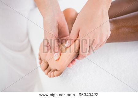 Pretty woman enjoying a foot massage at the health spa
