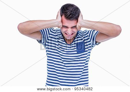 Angry hipster with hands on head on white background