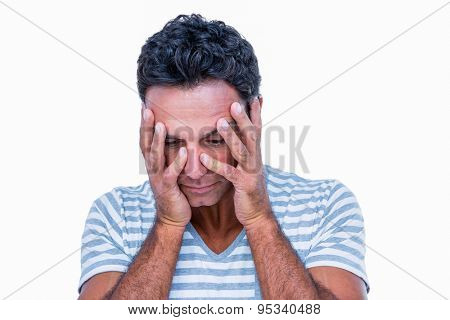 Sad man with hands on head on white background