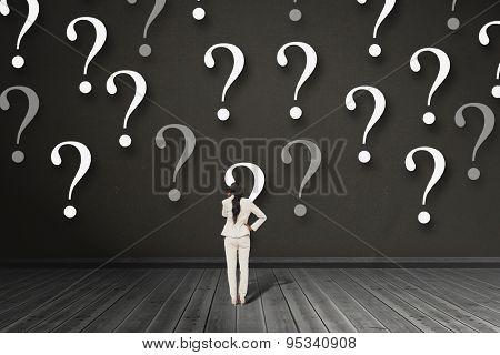 Thinking businesswoman against dark room
