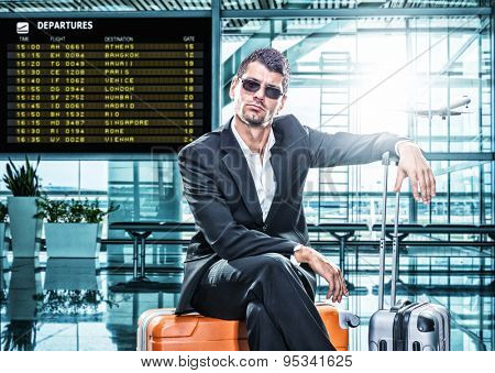 Business man in suit waiting at the international airport