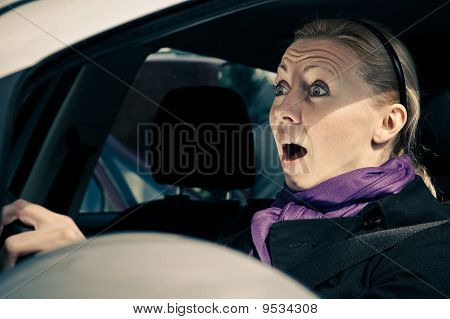 Young Woman Screams While Driving A Car