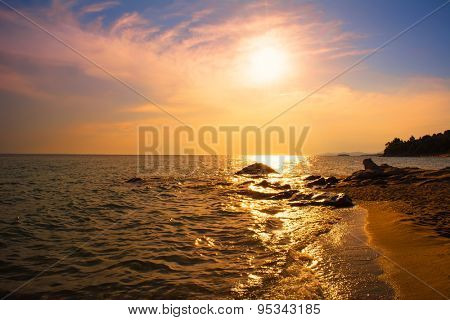 Sunset over the sea on the Karidi beach at Vourvourou, Greece