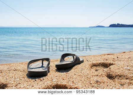 Male flip-flops on the beach