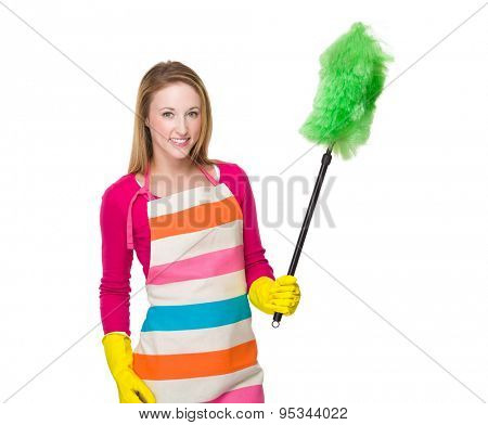 Young woman using the duster