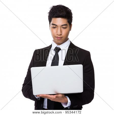 Chinese mixed Indian businessman use of the laptop computer