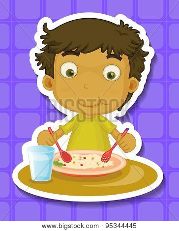 Boy sitting and eating the meal