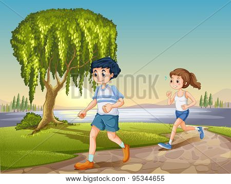 Man and woman jogging in the park at daytime