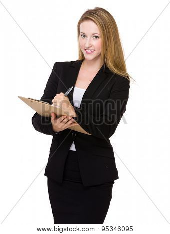 Caucasian businesswoman take note on clipboard